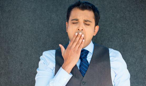 bored man yawning